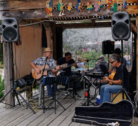 Matakana Farmers Market, MatakanaNew Zealand – November 4, 2017: A band entertaining at the Matakana Farmers Market, Matakana, New Zealand.