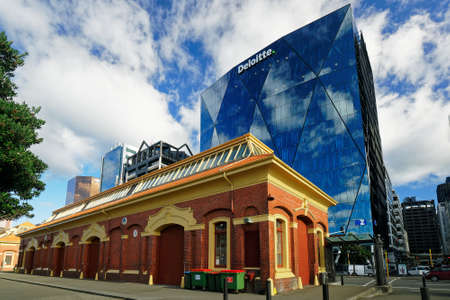 Wellington, WellingtonNew Zealand – May 25, 2019: Shed 13 in front of the Deloitte building, Customhouse Quay, Wellington, New Zealand.