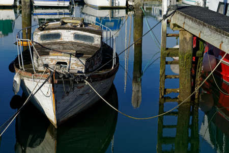 An old yacht in need of tender loving care, a doer upperer, New Zealand.