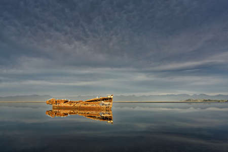 Janie Seddon shipwreck, the rust glowing in the evening sunlight, Motueka, New Zealand.