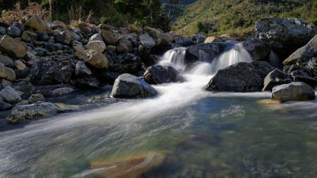 A waterfall or cascade on Hacket Creek, beside the Hacket track, Mount Richmond Forest Park, New Zealand. Imagens