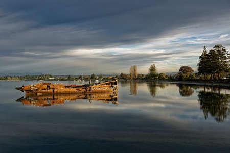 Janie Seddon shipwreck glowing in the evening sunlight, Motueka, New Zealand.