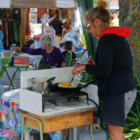 Motueka, TasmanNew Zealand – December 13, 2015: Whitebait sandwich being prepared on a Motueka Sunday market stall, New Zealand.