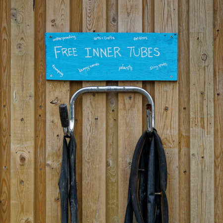 Recycling centre sign - rubber bicycle inner tubes suggested use for fetishes.