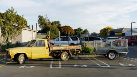 Inconsiderate parking, a pick up truck and trailer parked across three push chair and baby parking bays. New Zealand.