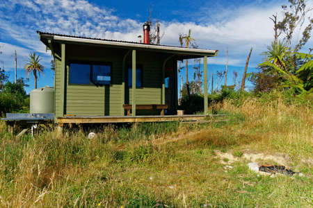 Abel Tasman National Park, Tasman Region/New Zealand - March 7, 2017: Dept of Conservation Awapoto Hut hiker accommodation, Inland Track, Abel Tasman National Park, New Zealand. Editorial