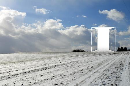 snowy field: Open door to nowhere on a snowy field Stock Photo