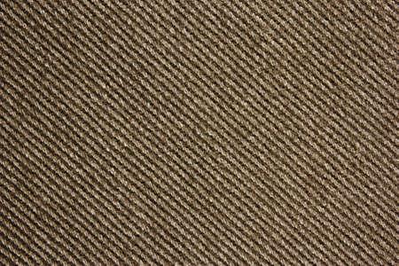 brownish: Closeup of brownish jeans fabric