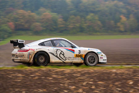 gt3: FLEINHEIM, GERMANY - OCTOBER 5, 2013  Timo Bernhard and Michael K�lbach driving their Porsche 911 GT3 at the ADAC Rallye Baden-W�rttemberg on October 5, 2013 in Fleinheim, Germany  Editorial