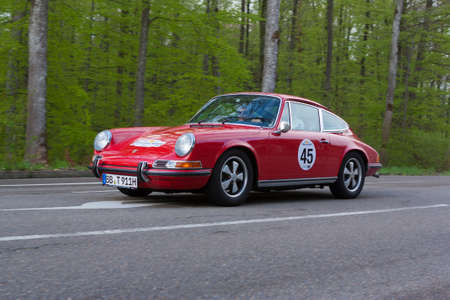 HEIDENHEIM, GERMANY - MAY 4, 2013: Sebastian Krebs and Boris Apenbrink in their 1971 Porsche 911T at the ADAC Wurttemberg Historic Rallye 2013 on May 4, 2013 in Heidenheim, Germany.