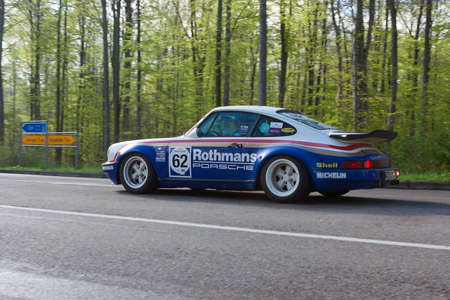 richter: HEIDENHEIM, GERMANY - MAY 4, 2013: Ernst Richter and Annette Friess in their 1981 Rothmans Porsche 911 at the ADAC Wurttemberg Historic Rallye 2013 on May 4, 2013 in Heidenheim, Germany. Editorial