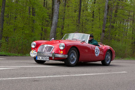 HEIDENHEIM, GERMANY - MAY 4, 2013: Armin Labor and Nicolai Kroger in their 1958 MG A at the ADAC Wurttemberg Historic Rallye 2013 on May 4, 2013 in Heidenheim, Germany.