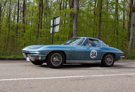 HEIDENHEIM, GERMANY - MAY 4, 2013: Paul Perthen and Claudia Stickel in their 1964 Chevrolet Corvette C2 at the ADAC Wurttemberg Historic Rallye 2013 on May 4, 2013 in Heidenheim, Germany. Editorial