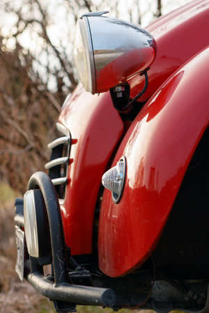 HEIDENHEIM, GERMANY - MARCH 13, 2017: Close-up photo of the front of a red Citroen 2CV car on March 13, 2017 near Heidenheim, Germany.