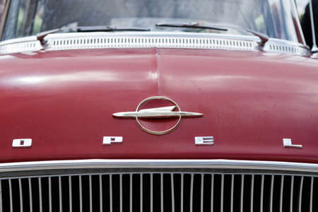grille: LUDWIGSBURG, GERMANY - APRIL 23, 2017: Opel Olympia Rekord oldtimer car at the eMotionen event on April 23, 2017 in Ludwigsburg, Germany. Close-up of the grille, hood and front emblem.
