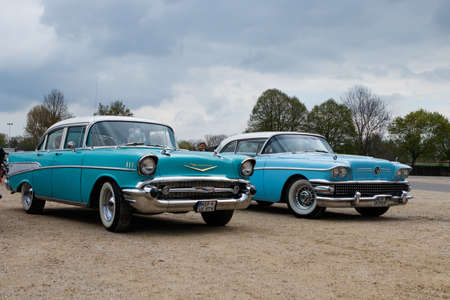 NORDLINGEN, GERMANY - APRIL 29, 2017: Buick Special and Chevrolet Bel Air oldtimer cars at the MotoTechnika oldtimer meeting on April 29, 2017 in Nordlingen, Germany. Front side view. Editorial