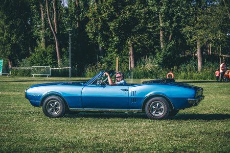 Heidenheim, Germany - July 8, 2018: 1967 Pontiac Firebird at the 2. Oldtimer day in Heidenheim an der Brenz, Germany. Редакционное