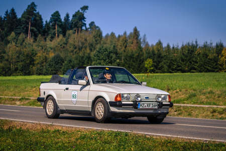 Augsburg, Germany - September 30, 2018: 1985 Ford Escort 1.6i Cabrio oldtimer car at the Fuggerstadt Classic 2018 Oldtimer Rallye.