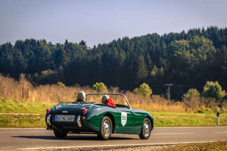 Augsburg, Germany - September 30, 2018: Green cabrio oldtimer car at the Fuggerstadt Classic 2018 Oldtimer Rallye. Publikacyjne