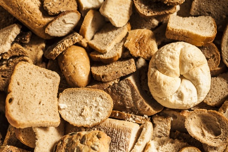 baked  goods: Many slices of stale bread and other stale baked goods  Stock Photo