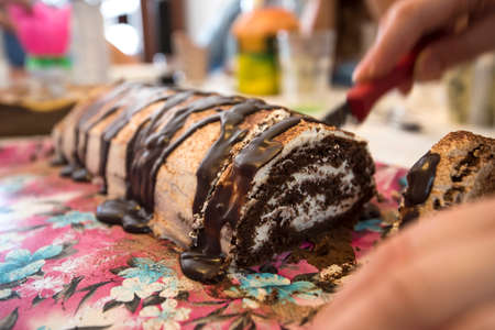 roulade: slicing roulade cake in birthday party