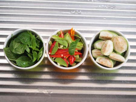 thai basil: Thai red curry ingredients - Thai basil, Red  Green chili and Thai eggplant Stock Photo