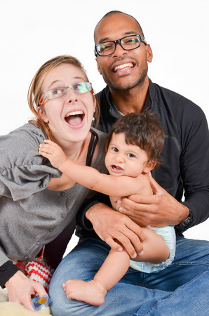 Happy interracial family is laughing
