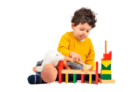Boy is playing and learning with didactic toys photo