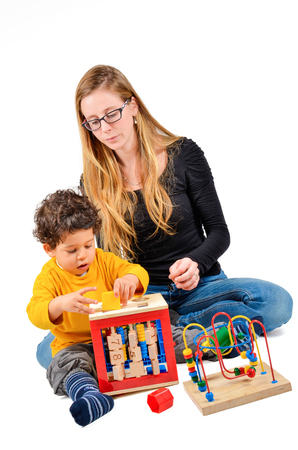 Mother and son are playing together as part of the creative children therapy Stock Photo - 28458584