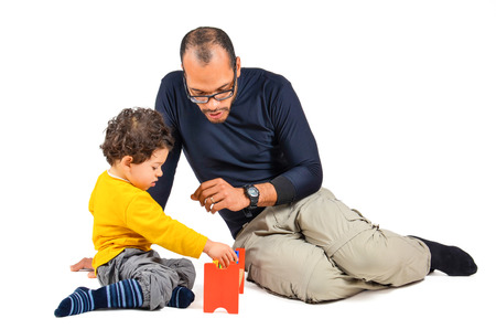 Father and son are playing together as part of the didactic children therapy 写真素材