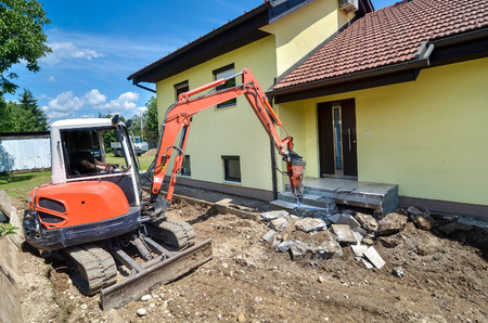 demolished: A house is being forclosed and demolished with a crusher Stock Photo