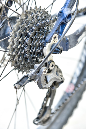 Bicycle gears and rear derailleur.  Studio shot on white background photo