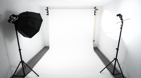 self made: Amateur home made photo studio in the basement. Inexpensive Self made background in the photo studio.