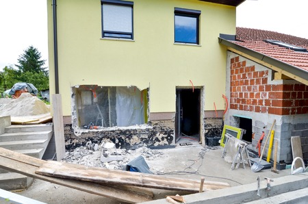 compacting: Rebuilding a family house and adding an  extension, opening walls and making a new terrace. Construction tooly