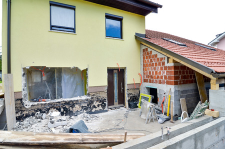 Rebuilding a family house and adding an extension, opening walls and making a new terrace. Construction tools 写真素材