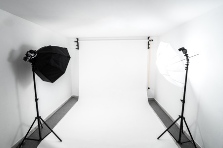 Amateur home made photo studio in the basement. Inexpensive Self made background in the photo studio.