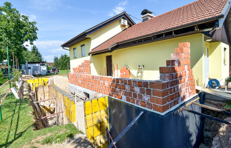 building tool: Rebuilding a family house and adding an  extension. Setting up a construction site with formwork.. Stock Photo