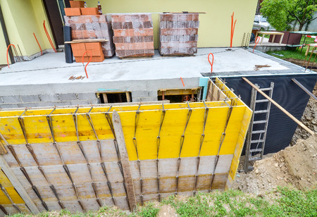 formwork: Rebuilding a family house and adding an  extension. Setting up a construction site with formwork.. Stock Photo