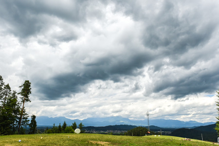 bad times: Thunderstorm clouds over a green village. Dramatic weather, great for composing or background. Stock Photo