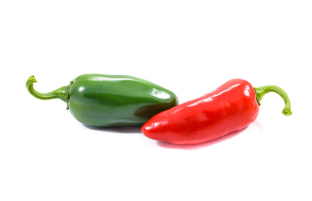 Red and green ripe jalapeno chili hot pepper from caribbean or mexico isolated on white background Standard-Bild