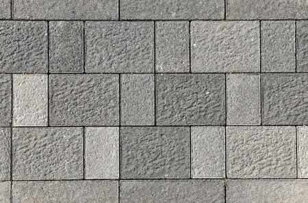 road paving: Concrete or cobble gray pavement slabs or stones  for floor, wall or path. Traditional fence, court, backyard or road paving.