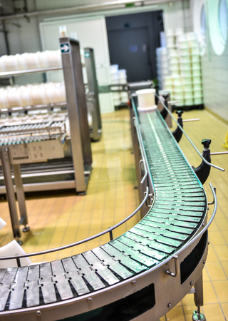 provola: Conveyor in a cheese factory with a plastic cheese mold Stock Photo