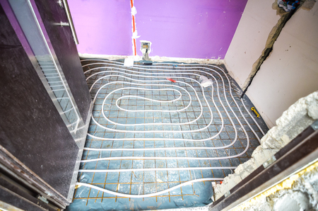 adaptation: Floor Heating instalation in house renovation, adaptation. Rebuilding old house Stock Photo