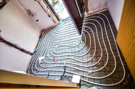 Floor Heating instalation in house renovation, adaptation. Rebuilding old house Archivio Fotografico