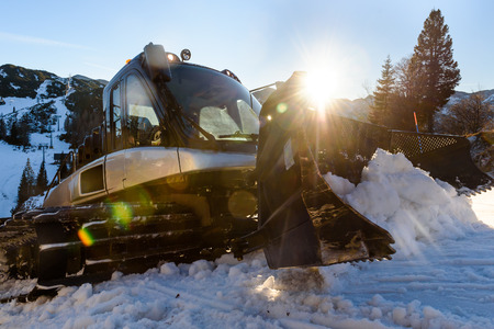 snow grooming machine: Snowplow Snowcat Ski slopes maintenance on the mountains ski resort Stock Photo