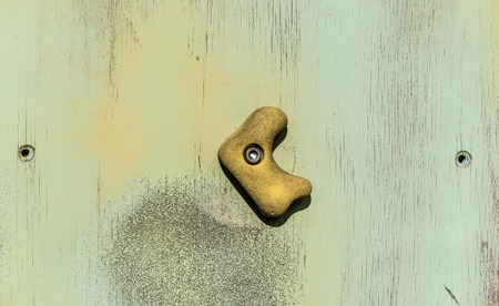 strut: Old and obsolete toe and hand hold studs on wooden old textured wood Stock Photo