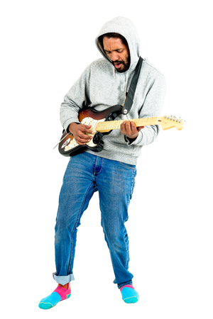 jamming: Man is playing electric guitar. Musician performer wearing hoodie and jeans is jamming on his instrument. Isolated on white.