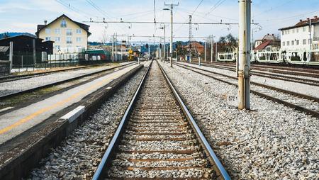 railroad station platform: Railroad station,  railroad tracks and a cargo platform for trains Stock Photo