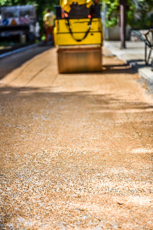 vibroroller: Construction roller or steamroller during road construction. Asphalt pavement works. Stock Photo