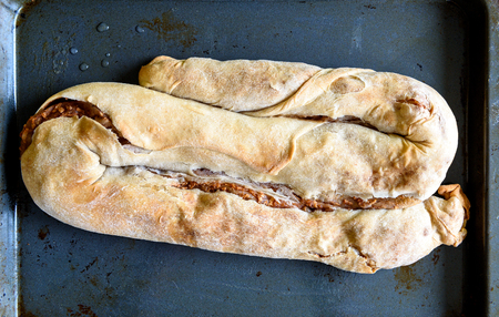 fillo: Ready made Homemade Apple Strudel, Pie, Burek or other kind of pastry appetizer or sweets on a backing tray. Stock Photo